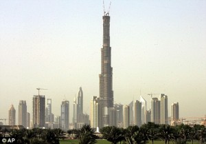 Towering debts: Burj Dubai, the tallest building in the world, now looms over half-e