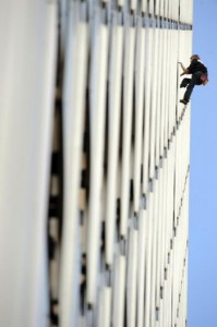 French climber Alain Robert, a.k.a. 'Spiderman,' will climb the new Burj Khalifa in Dubai. Here, Robert climbs the front of the Ariane building, a 755 foot tower, on Oct. 8, 2009 in La Defense, outside Paris. (BORIS HORVAT/AFP/Getty Images)