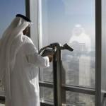 Dubai's lofty ambitions such as the Burj Khalifa, the world's tallest building, have cast a long shadow. Kamran Jebreili / AP Photo