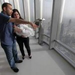 Amjad Hanna and Maram Haddad show Afif the view from the 124th floor. Jaime Puebla / The National