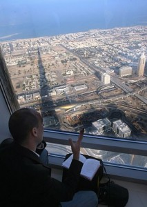 A journalist reporting from the top floor of Dubai's Khalifa tower, the world's tallest building, in January