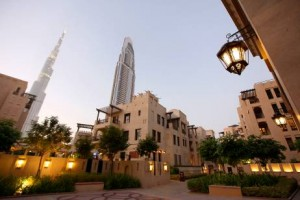 Burj Khalifa and The Address hotel rises above the Old Town. Although the neighbourhood might at first seem identikit, the old-Arabian architectural touches set the tone for a friendly, village-like environment.  Pawan Singh / The National