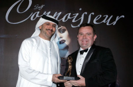 Chris Buxton receiving the Gulf Connoisseur award from Twenty First Century Publishing director Hadi Al Abbas.