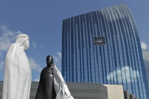 The white marble and black granite figures of a man in a khandoura and a woman in an abaya, called Together, have been placed on Emaar Boulevard, close to the entrance of the Burj Khalifa.  Courtesy of Emaar