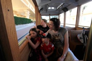 Tourists enjoy the free ride on the new trolley buses serving the Burj Khalifa and The Dubai Mall area.  Satish Kumar / The National
