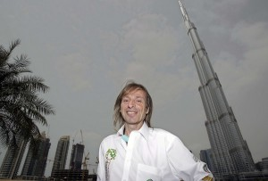 "French climber Alain Robert, also known known as the ""French Spiderman,"" poses in front of Burj Khalifa, the world's tallest tower. (Kamran Jebreili, Associated Press / March 28, 2011)"