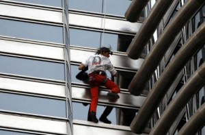 "Alain Robert took little more than six hours to climb the Burj Khalifa, finishing just after midnight and calling it a ""big moment in my life"".  AP"