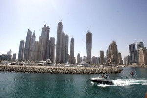 (KARIM SAHIB/AFP/GETTY IMAGES) - A speed boat exits the new Dubai Marina with its high rise apartment towers.