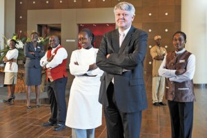 Staff at the Movenpick Ambassador Hotel Accra in Ghana, wearing uniforms designed by Emile Rassam  Courtesy Movenpick