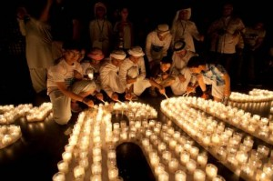 Emirati boys light candles at Burj Plaza in Dubai as the lights go off at the Burj Khalifa.  Randi Sokoloff for The National