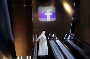 An Emirati man stands on an escalator during the Facebook opening of the first Middle East and North Africa office at the Armani hotel in Dubai, United Arab Emirates, Wednesday, May 30, 2012. (Kamran Jebreili / AP)  Read more: http://www.timesunion.com/news/article/Facebook-launches-Mideast-office-in-Dubai-3595309.php#ixzz1xpxPFuZR
