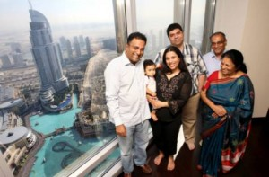 Image Credit: XPRESS/Virendra Saklani     NO WORRIES: Manju Chadrashekar (left) with his family in his 66th floor Burj Khalifa apartment. They won't have to fight the crowds on the big night