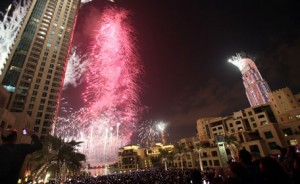 Fireworks illuminate Burj Khalifa while thousands of people gather to celebrate the New Year at midnight in Dubai on January 1, 2013. (AFP)