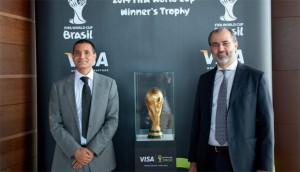 Marcello Baricordi and Karim Beg with the 2014 Fifa World Cup winner's trophy. — Supplied photo