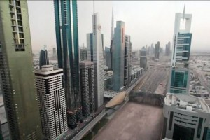 A computer-generated image from the television show Strip the City, shows Sheikh Zayed Road in Dubai being rolled up like a carpet to reveal deep sand beneath. Courtesy Discovery Channel