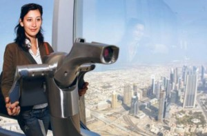 Image Credit: Gulf News Archives View At The Top. A visitor tries out the electronic telescope at Burj Khalifa's 124th floor observatory deck